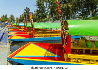 Brightly colored boats docked in Xochimilco canals in Mexico City
