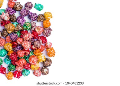 Brightly Colored Candied Popcorn, white background. Horizontal image of Junk food, fruit flavored popcorn. Colorful, rainbow, candy coated popcorn. Shallow focus on popcorn in bowl. Isolated on white