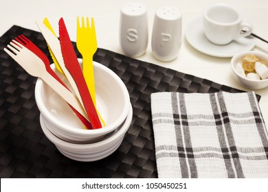 Brightly colored cutlery within serving bowls, with other condiments to the side