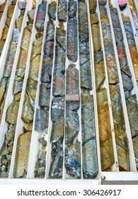 Brightly colored drill core logged in trays from epithermal gold and copper deposit. Australia.