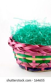 brightly colored easter basket with green holiday grass