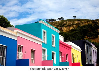 Brightly colored houses of Bo-Kaap, Cape Town. South Africa. The stunning view of Signal Hill from Bo-Kaap. The British style colorful buildings in the Muslim Malay Quarter, the former township.