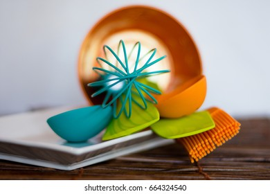 Brightly colored kitchen utensils in an orange canister