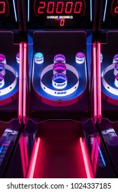 Brightly Colored Lights of Skee-ball Arcade Game