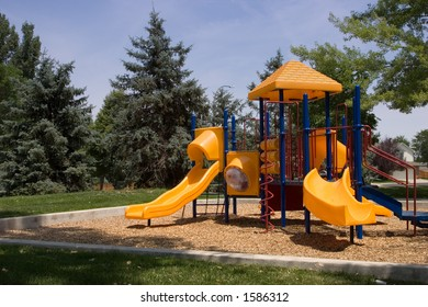 A brightly colored playground waits ready for child play.