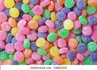 Brightly colored and sugar coated candy as a background.