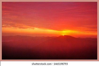 brightly colored sunrise in mountains