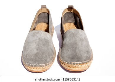 Brightly colored traditional slippers shoes espadrilles. Espadrilles isolated on White background