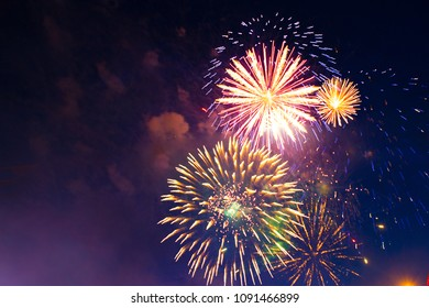 Brightly colorful fireworks in the night sky.