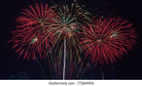 Brightly colorful fireworks in the night sky. New Year celebration fireworks