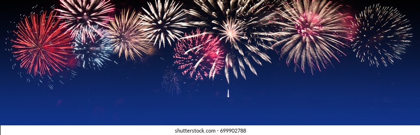Brightly Colorful Fireworks on twilight background - party celebration concept