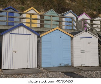 Brightly Coloured Beach Huts in the Coastal Village of Beer on the Coast of Devon, England, UK