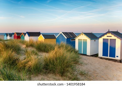 Brightly coloured beach huts at Southwold on the Suffolk coast