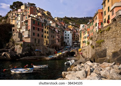 The brightly coloured houses of Riomaggiore, one of the five villages of the Cinque Terre, Liguria, Italy.