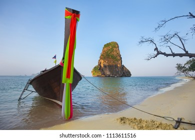 Brightly decorated traditional boat at  tropical beach, Krabi, Thailand