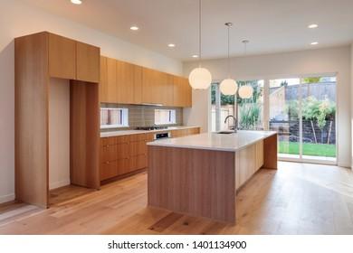 A brightly light modern kitchen with a modern design