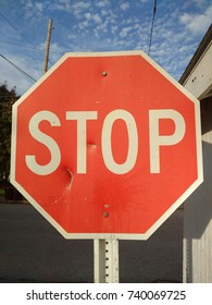 Brightly Lighted Stop Sign with Some Wear