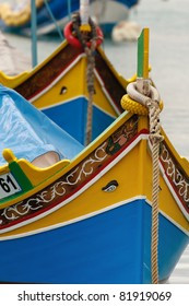 "Brightly painted fishing boats with the ""Eyes of Osiris"" in Marsaxlokk on the island of Malta"