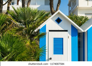Brightly painted summer beach change rooms at at Jesolo beach in Italy