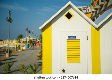 Brightly painted summer beach change rooms at Jesolo beach in Italy.
