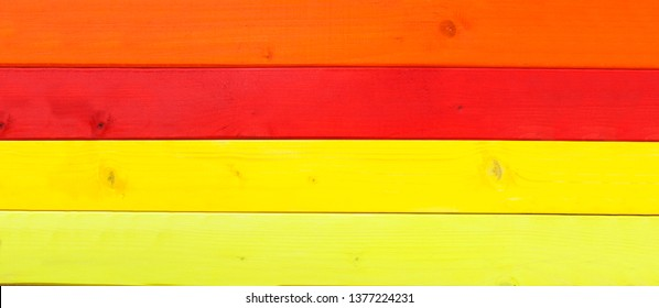 Brightly painted wood, in beach holiday or vacation style, as a wooden background panorama.