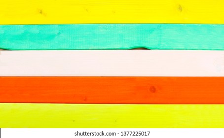 Brightly painted wood, in beach holiday pastels or vacation style, as wooden backgrounds.