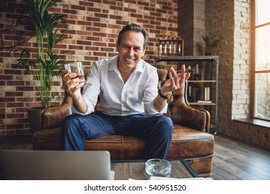 Brightly smiling middle aged man relaxing