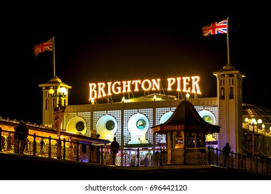 BRIGHTON, AUGUST 11, 2016: Brighton Pier at Night. Brighton Marine Palace and Pier, or the Palace Pier is a Grade II listed pleasure pier in Brighton, England. It opened in 1899
