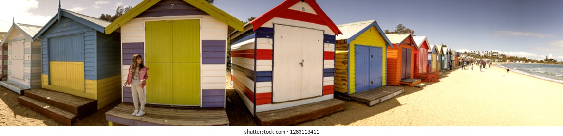 BRIGHTON BEACH, AUSTRALIA - SEPTEMBER 7, 2018: Panoramic view of colourful Beach Huts. They are a famous attraction for tourists.