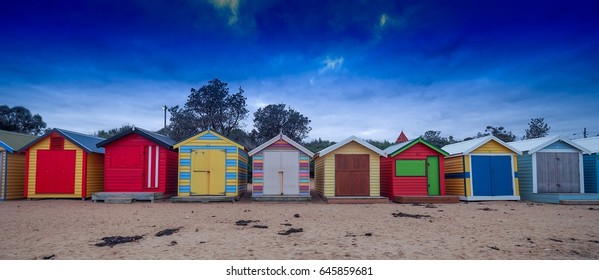Brighton beach boxes with string blue sky