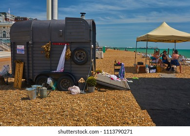 Brighton beach, Brighton and Hove, East Sussex, England, June 15th 2018 a pop up sauna on the beach made from a horse box, wood fired and very popular