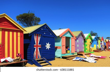 Brighton Beach Melbourne Multi Coloured bright and colourful Beach Huts with australian flag painted