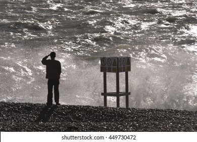 Brighton Beach, Sussex, United Kingdom, 23rd, October, 2013: Man looks on after man drowns..