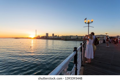 Brighton, East Sussex /England - August 7 2018: Sunset over Brighton and Hove from Palace Pier, East Sussex, England, United Kingdom, Europe