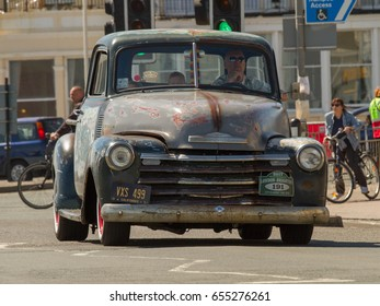 BRIGHTON ENGLAND 4th JUNE 2017: London to Brighton Classic Car Run 4.06.17 in Brighton: Old classic Chevrolet with stripped paint