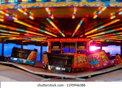 Brighton, England - April 15, 2011:  Waltzer Cars on Ride at Fairground, The Waltzer ride was invented in Cheshire, England around 1920.