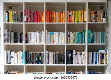 Brighton, England - August 03 2019: White wooden bookcase filled with books in a UK home setting
