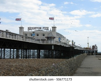 Brighton , England July 9,  2009:  Brighton Pier with union flags blowing in the wind.