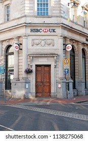 BRIGHTON, ENGLAND - JULY 9, 2018: Facade of HSBC Bank branch office in North St, Brighton, UK. HSBC Bank plc is one of the largest banking and financial services organisations in the world.