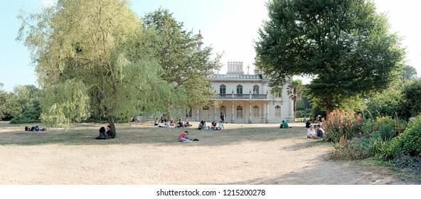 BRIGHTON, ENGLAND - JULY 9, 2018: Visitors in Brighton Pavilion Garden in New Road, Brighton, UK. The Pavilion Garden is the only completely restored Regency Garden in UK.