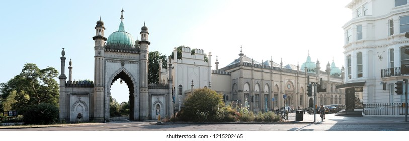 BRIGHTON, ENGLAND - JULY 9, 2018: Panoramic view of the vintage archway to Brighton Pavilion Garden in Church St, Brighton, UK. The Pavilion Garden is the only completely restored Regency Garden in UK
