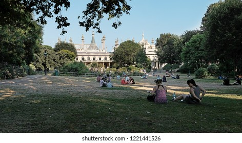 BRIGHTON, ENGLAND - JULY 9, 2018: Visitors in the Pavilion Grounds in New Road, Brighton, UK. The Pavilion Garden is the only completely restored Regency Garden in UK.