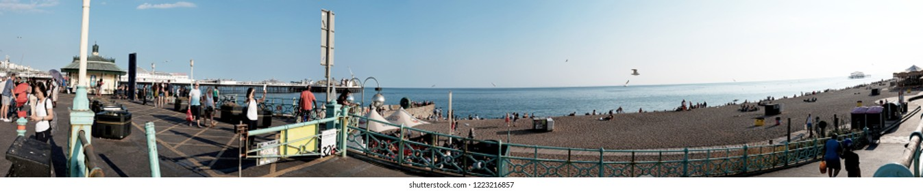 BRIGHTON, ENGLAND - JULY 9, 2018: Panoramic view of Brighton Beach, Brighton, UK. Brighton is the most popular seaside destination in the UK for overseas tourists.