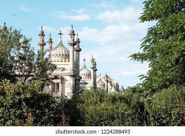 BRIGHTON, ENGLAND - JULY 9, 2018: View of Brighton Pavilion from the Pavilion garden in New Road, Brighton, UK. The Indo-Saracenic building build in 1787 is a Grade I listed heritage building in UK.