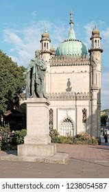 BRIGHTON, ENGLAND - JULY 9, 2018: George IV statue at the North Gate of the Brighton Pavilion in Church St, Brighton, UK. The statue erected in 1828 was designed by Sir Francis Chantrey.