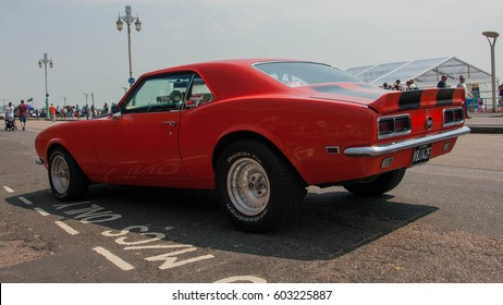 BRIGHTON ENGLAND JUNE 5 2016: London to Brighton Kit & Sports Car Run in Brighton red 1967 Chevrolet Camaro SS 350 back side close up