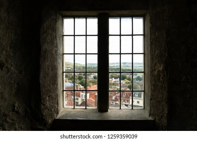 Brighton, England - October 3, 2018:   Inside of Lewes Castle, East Sussex county town with old windows and house, city town, garden outside of the windows for background.