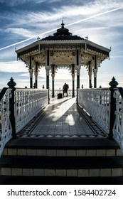 Brighton, England; September 2019: Brighton Beach Bandstand with a couple of travelers in love