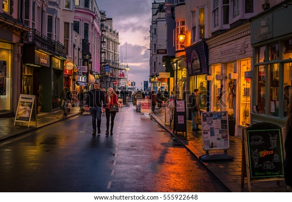 Brighton, England, UK, 14 January 2017. Brighton street , with shops and restaurants, just before sunset.