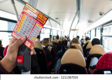 Brighton, England-1 October,2018: Student or tourism holding the Brighton & Hove seven day saver bus pass ticket at bus bell switch inside the public bus route.
